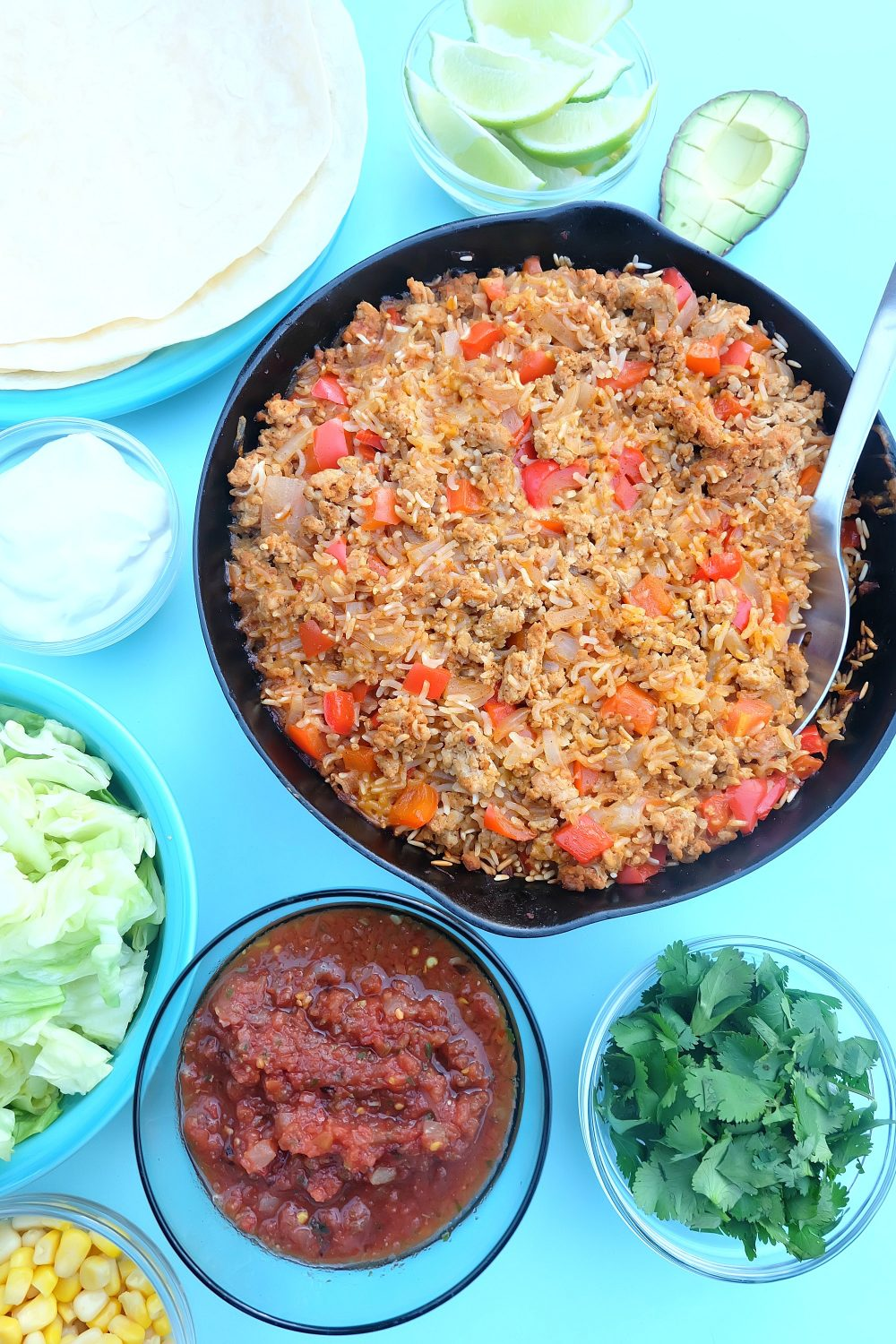 Looking for a quick and easy, one pan healthy dinner idea that will feed a crowd? This ground turkey and rice Mexican casserole recipe only takes 10 minutes to prep, then you pop it in the oven. Perfect for filling tacos, burritos or using as a topping for taco salad! A healthy, delicious and family friendly meal idea! #MakeItWithTurkey #Recipe #Mexican #Turkey #OnePan