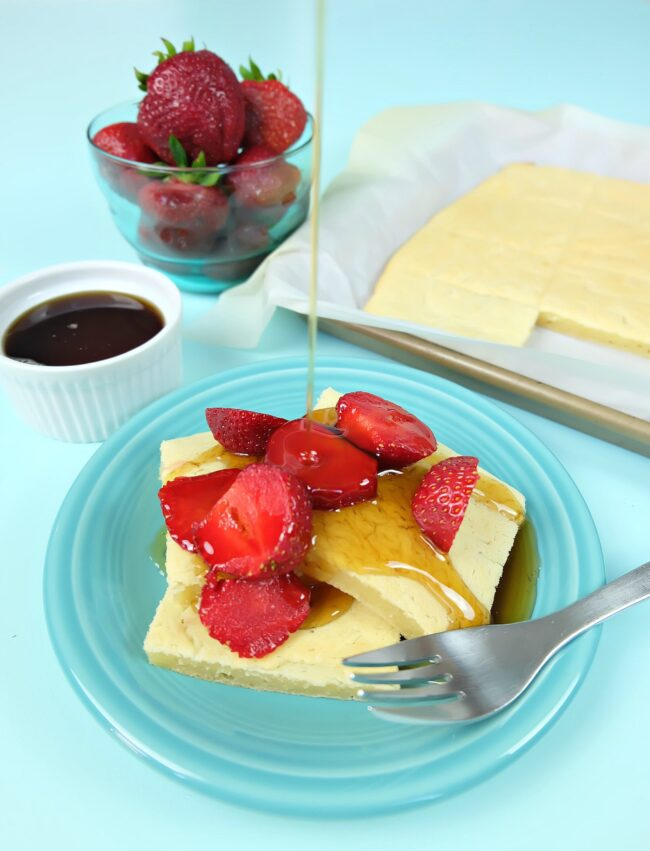 We've taken our favorite Japanese candy and turned it into and quick and delicious breakfast with our easy sheet mochi pancakes recipe! With a mochi filling and a golden crust, your family won't be able to get enough of these pancakes! Make the batter in less than 5 minutes and then and pop it in the oven for a low maintenance breakfast-- no pancake flipping required. Extras can be stored in the fridge for breakfast all week long! #Breakfast #mochi #pancakes #recipe