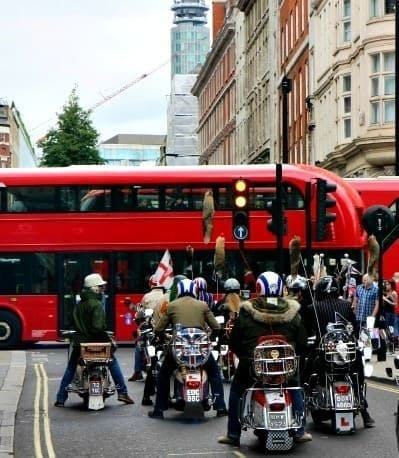 red bus and bikers