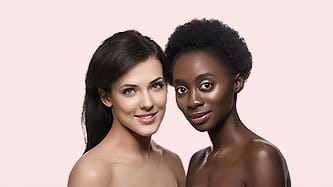 Two Fresh Faced Women Smiling About Clean Skin