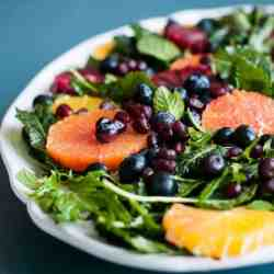 Raw Baby Kale Salad with Oranges, Blueberries + Pomegranate Seeds