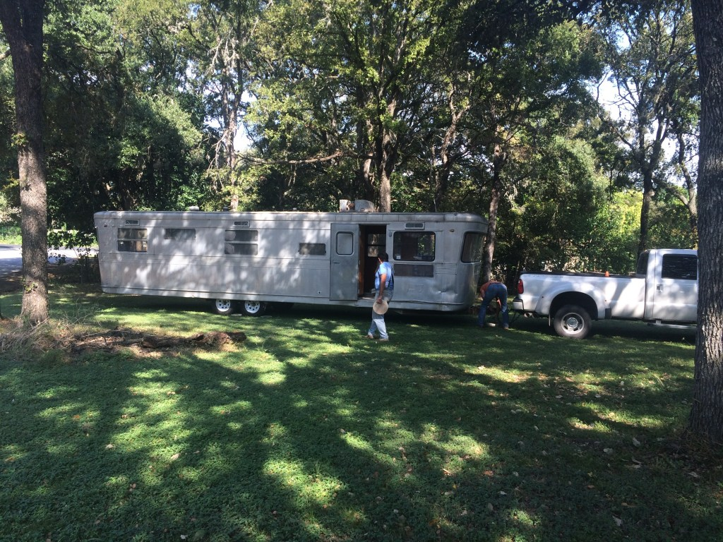 Towing 1955 Spartan Royal Mansion in Austin, Texas. To be renovated into trailer therapy office.