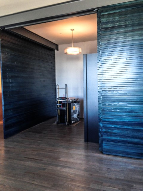Custom designed sliding blue panels Robin LaMonte/Rooms Revamped Interior Design