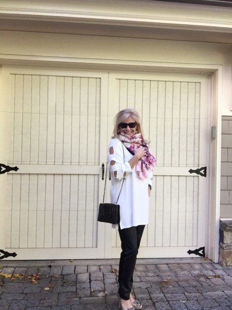 Robin LaMonte wears a pink silk floral wrap from WHBM as a scarf.