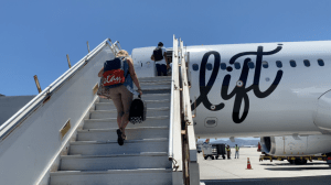 lady walking up stairs to lift plane