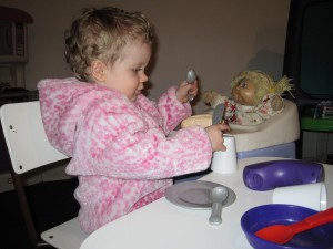 Flora playing with her aunt's Cabbage Patch Kid