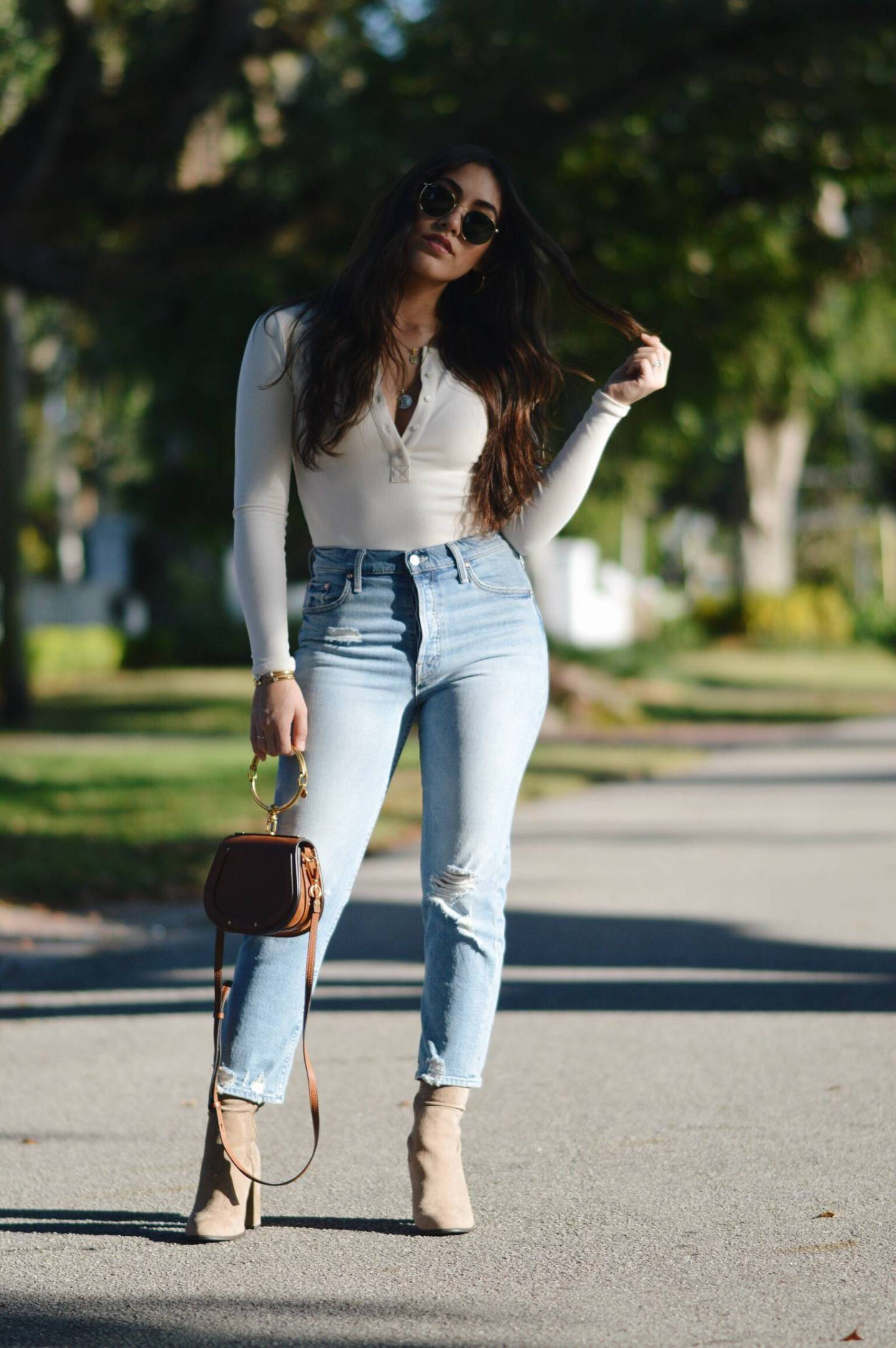 White-ivory-Body-Suit-with-high-wasted-jeans-and-brown-sock-booties