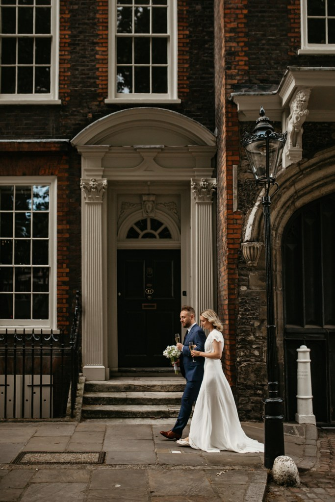 couple walking together in London wedding photograph