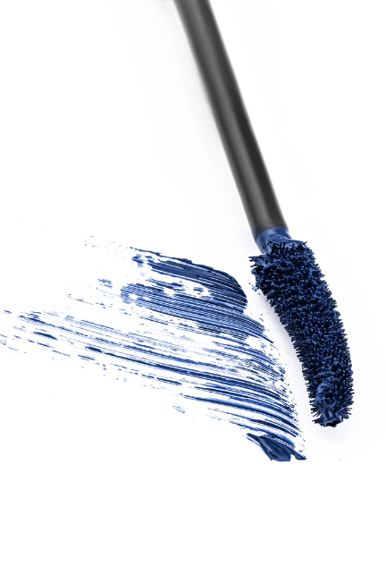 mascara wand with blue formula on it