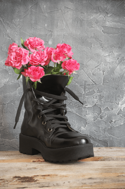 black combat boot with pink flowers in it
