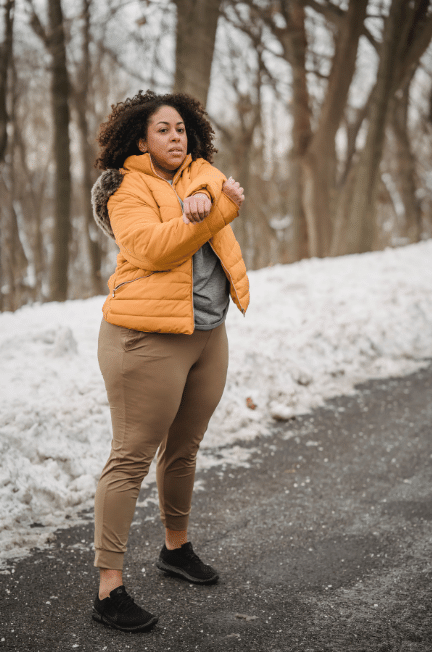 Woman wearing a yellow puffer jacket-something short and sweet can really be a good addition to your wardrobe. Check out the best plus size quilted jacket picks!