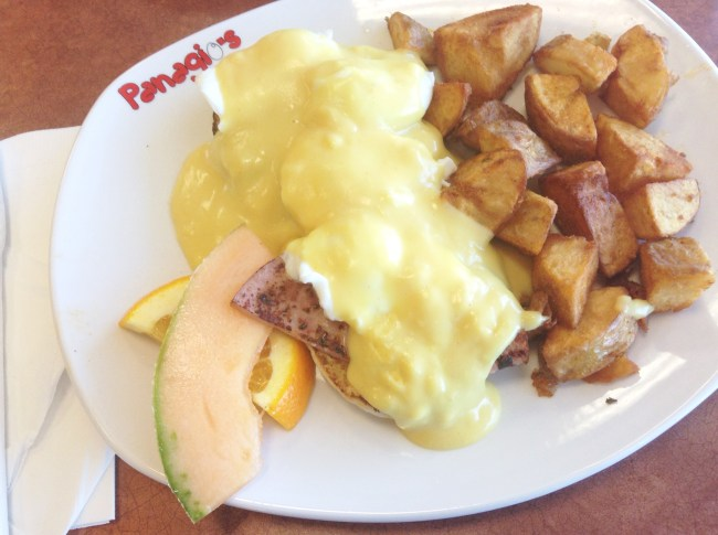 """Panagio's - """"Eggs Benny"""" - Ham, Eggs with Hollandaise Sauce on an English Muffin, Homefries, and Fruits - HELLOTERI"""