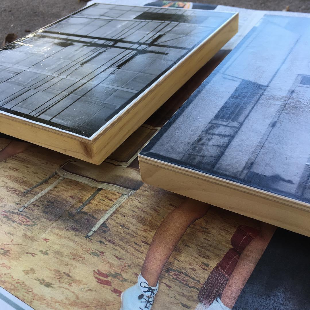 Photographs mounted on wood panels