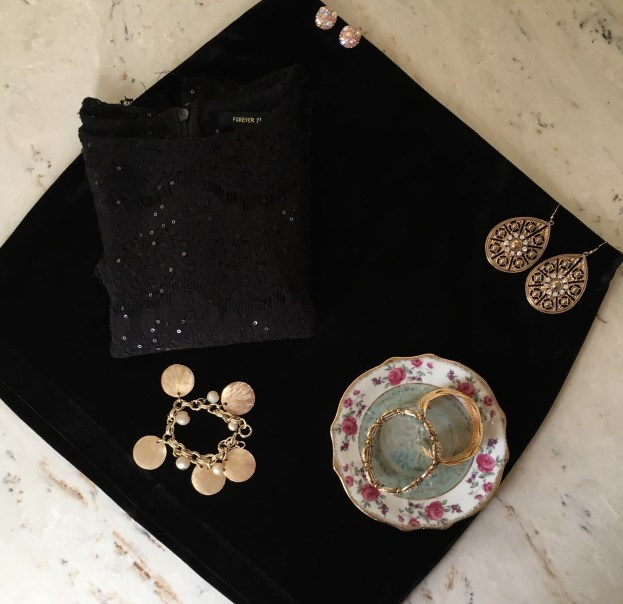 Black mini skirt from Express. Sparkly black crop top is from Forever 21. Gold chunky bracelet (bottom left) is vintage. Earrings (top right) are from Francesca's. Earrings (top left) are from Macy's.