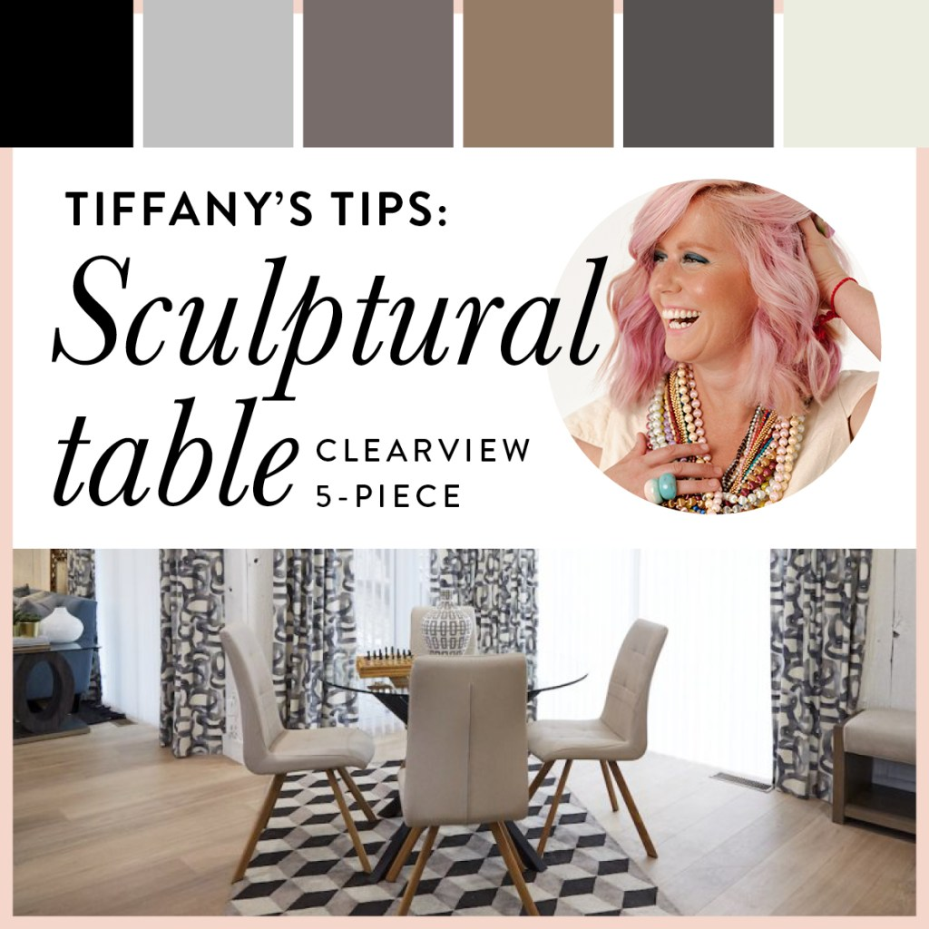 Glass top table with modern chairs are paired with earthy hues, including late, ivory and taupe.