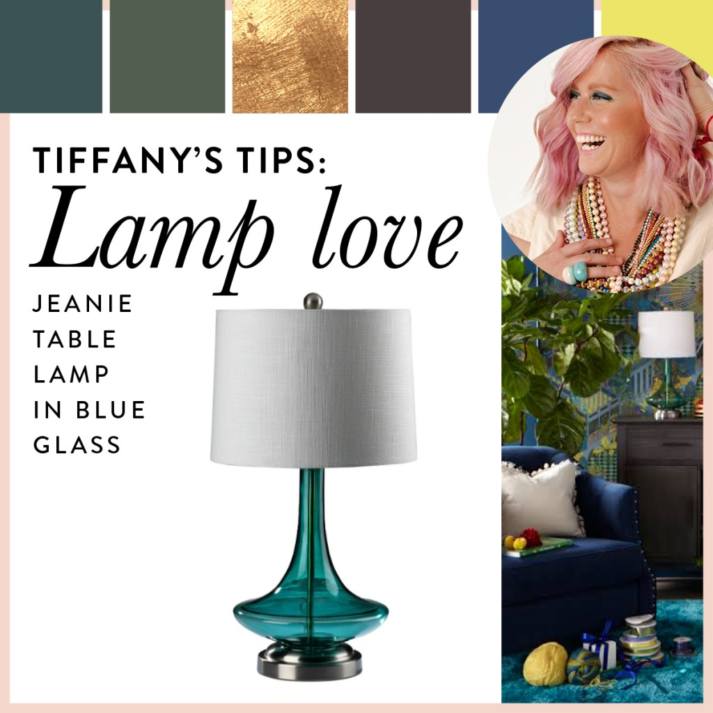 The blue glass table lamp is shown with rich and luxurious blues and greens
