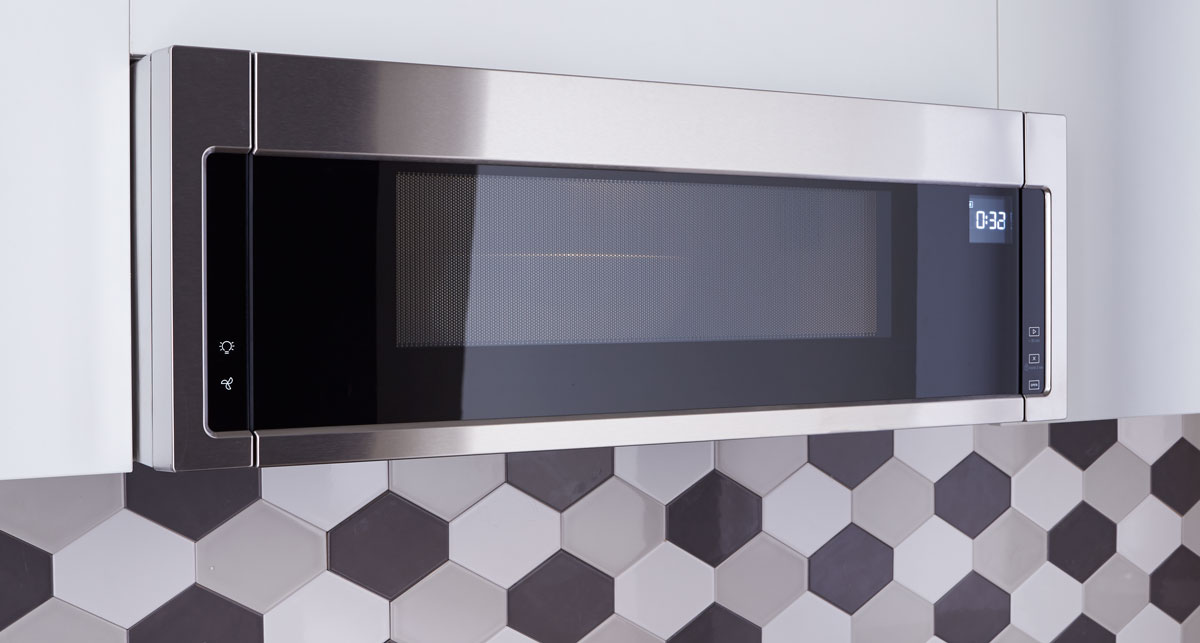 Modern kitchen over the range microwave and hood by Whirlpool