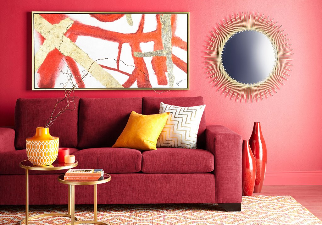crystal inspired decor with red sofa and wall art
