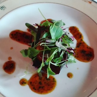 Heart of palm served on grilled aubergine with a sweet chilli and coriander dressing.