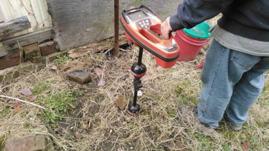 using a transmitter to locate sewer line to clean