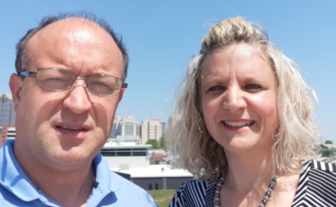 Bill Helmken, the company owner, and his wife Meigan Helmken pictured with downtown Pittsburgh, PA in the background