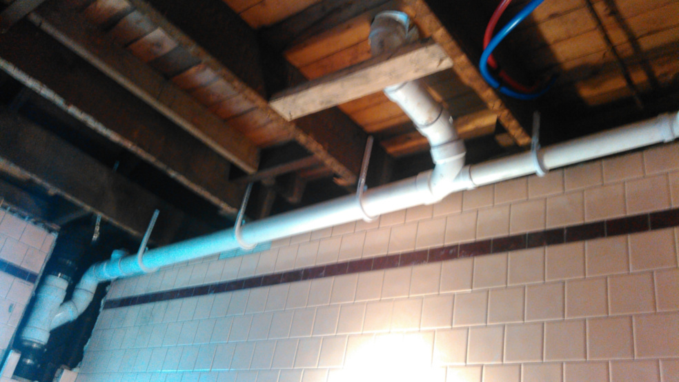 emergency plumbing repair after the walls and ceiling were cut to reach the pipe
