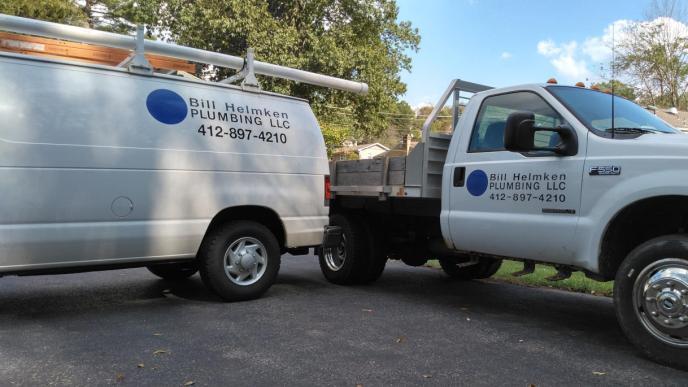 Bill Helmken Plumbing's fleet of work trucks