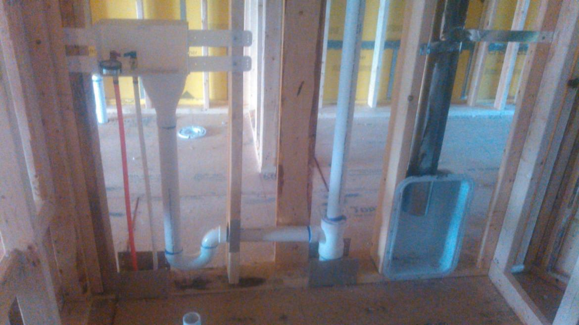 new construction plumbing above ground rough in wall laundry room PVC