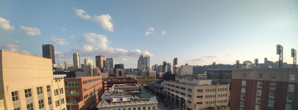 downtown Pittsburgh skyline seen from the North Side on a mostly sunny day