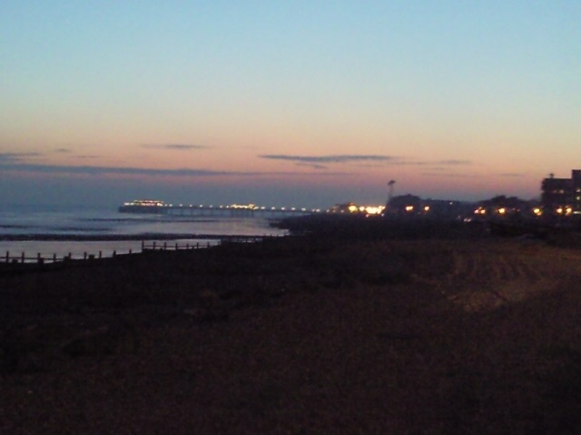 Worthing Pier in distance in fading twilight conditions.