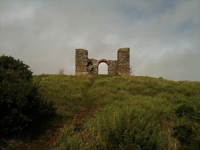 A ruin or folly atop a hill