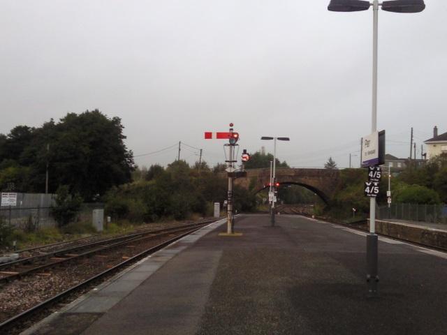 A platform at par station with semaphore signals visible