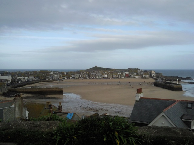 St Ives harbour with the Island looming behind it