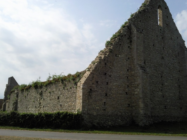 The ruins of a large stone barn