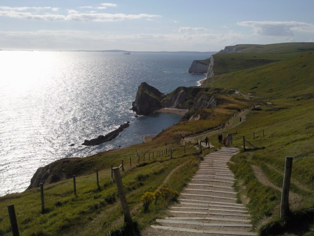 Steps leading down into St Oswalds Bay. Swyre Head is in th emiddle distance and the Isle of Portland on the horizon.