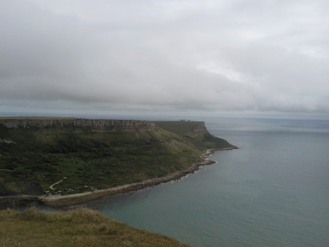 A V-shape depression in the opposite cliff, where Pier Bottom separates Emmetts Hill and St Aldhelm's Head