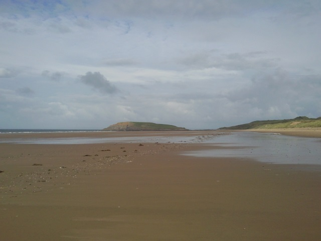 Burry Holms at the far end of Rhossili Bay