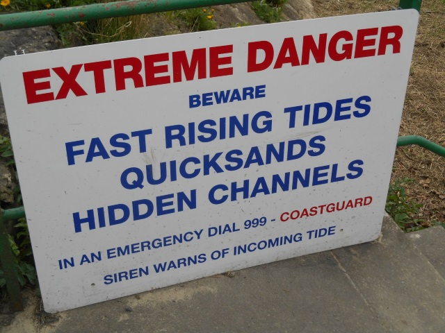 Sign: Extreme Danger, beware fast rising tides, quicksands, hidden channels. In an emergency dial 999 - coastguard. Siren warns of incoming tide.