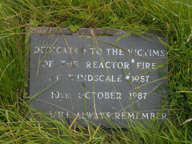 """Plaque: """"Dedicated to the victims of the reactor fire at Windscale 1957. 10th October 1987. We will always remember."""