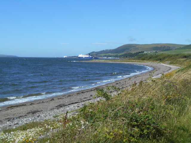 Cairnryan distant. A ferry is docked.