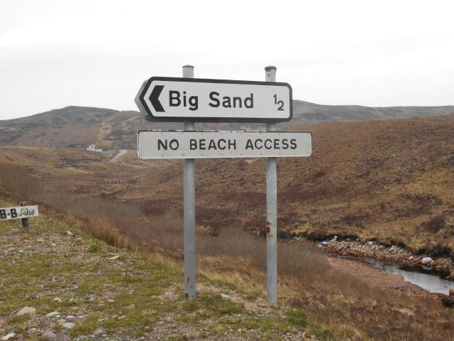 Sign: Big Sand ½. No Beach Access.
