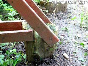 broken timber fence posts