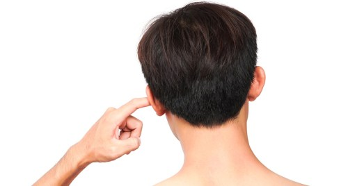 Person with finger in their ear.