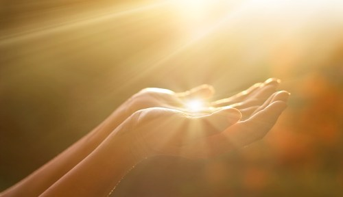 Picture of sunlight in hands.