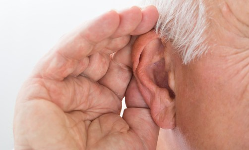 Picture of a guy with his hand up to his ear