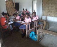 Kids in class with their teacher