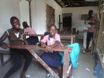 Kids sitting in the main school building
