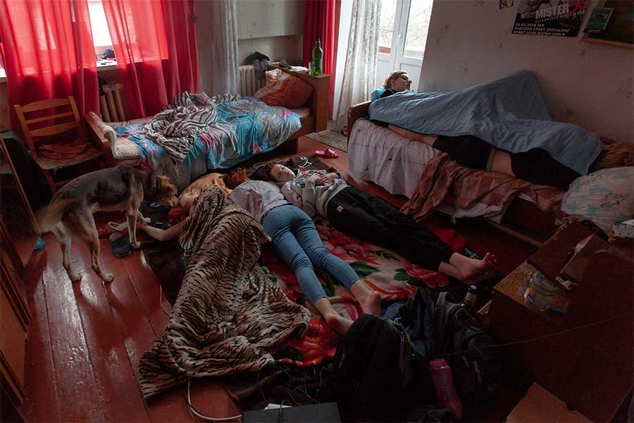 Punks sleep in the same room after the party from the series 100% girls punk-rock from East Europe by  Evgeni Attsetski