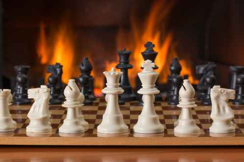 chess-board-game-fireside-strategy-541486