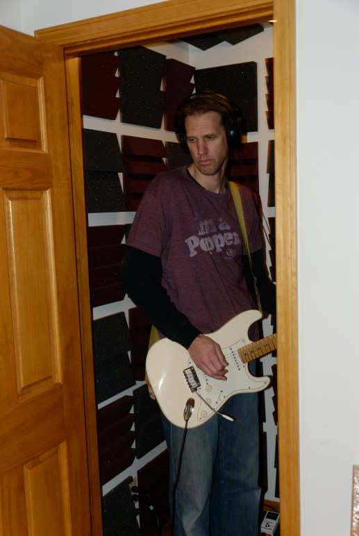 Mark in the vocal booth beneath the stairs